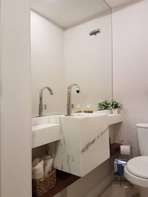 Lavabo com Cuba Esculpida : Banheiros modernos por Juliana Zanetti Arquitetura e Interiores