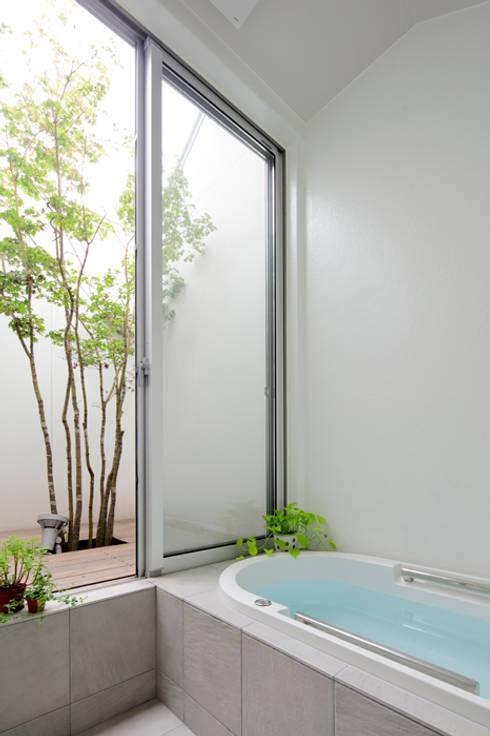 岩松の家: arc-dが手掛けた浴室です。
