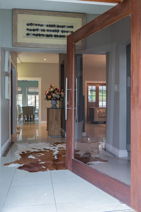 Contemporary meets African accents :  Windows & doors  by Indoni Interiors