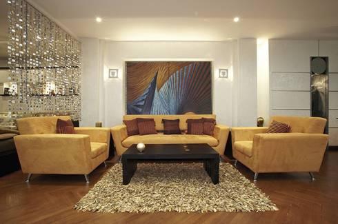 Dokki Apartment:  غرفة المعيشة تنفيذ Hazem Hassan Designs