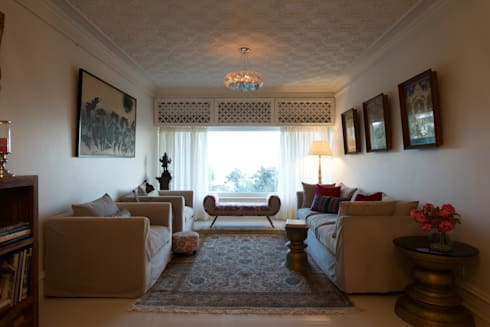 Premium home interior designs: asian Living room by Bric Design Group