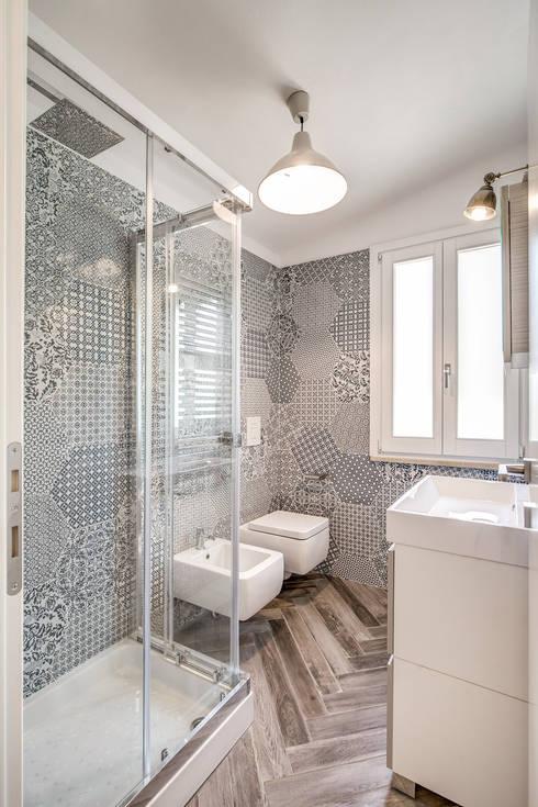 Ванные комнаты в . Автор – Studio Guerra Sas