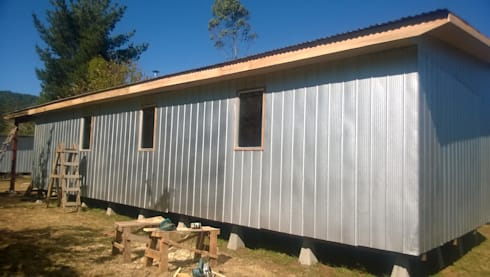 Casa Dollinco – Panguipulli: Casas unifamiliares de estilo  por C - Arq