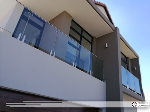 Modern balcony design:  Patios by Property Commerce Architects