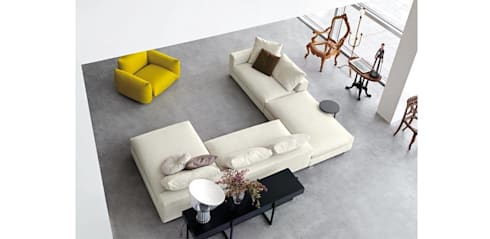 Elegant Designer Sofa's: modern Living room by Spacio Collections