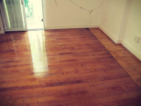 Lifted the Wooden Floor / New Flooring:   by CPT Painters / Painting Contractors in Cape Town