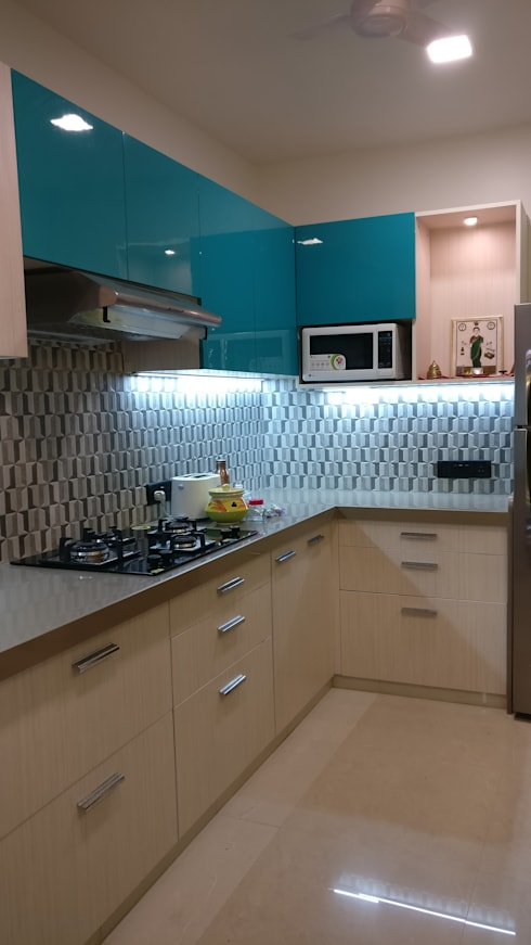 Mahim Residence got a blue touch:  Kitchen by Olive Roof