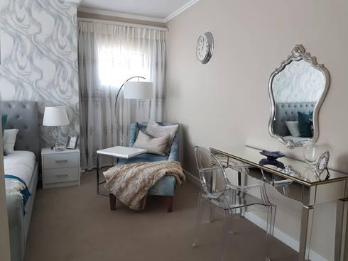 Navy & Teal Glamorous Bedroom: modern Bedroom by Sophistique Interiors
