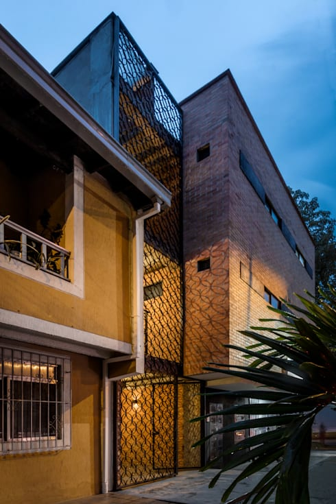 EDIFICIO 80 – 19: Casas de estilo moderno por PLANTA BAJA ESTUDIO DE ARQUITECTURA