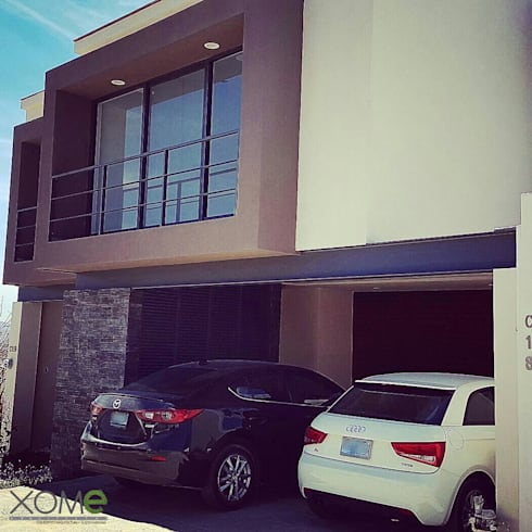 FACHADA PRINCIPAL LATERAL : Casas de estilo moderno por Xome Arquitectos