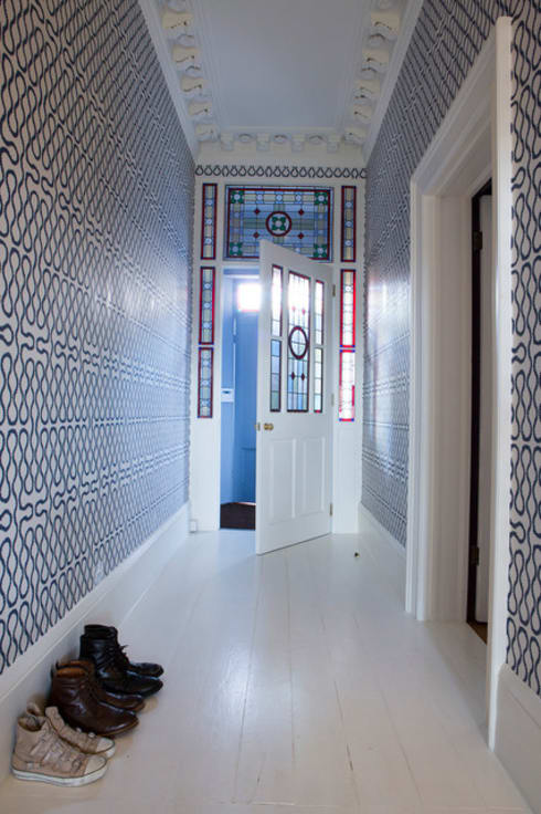 Hallway:  Walls & flooring by S. T. Unicom Pvt. Ltd.