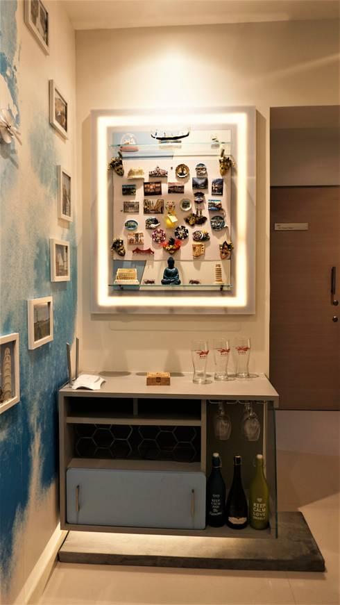 Travellers' Escape : modern Living room by DESIGN EVOLUTION LAB