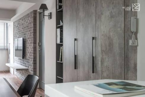 是收納櫃也是鞋櫃:  玄關、走廊與階梯 by 禾廊室內設計