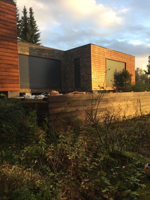Casa França - 105m2 : Casas de madeira  por JGDS-EPA - CASAS MODULARES
