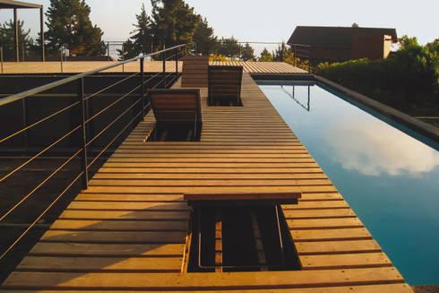 Casa Pati O: Terrazas  de estilo  por 2712 / asociados