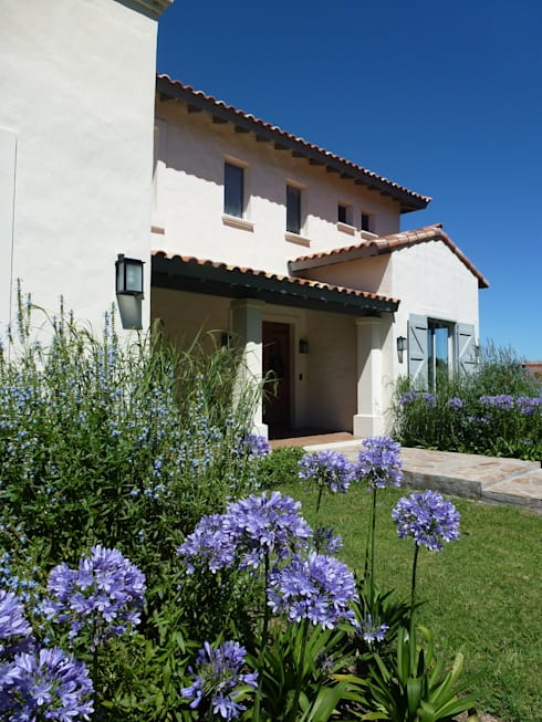 Casa en Haras San Pablo: Casas de estilo  por Estudio Dillon Terzaghi Arquitectura
