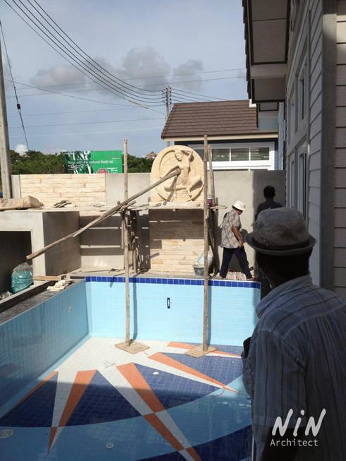 Pool villa American style:   by NIN Architect