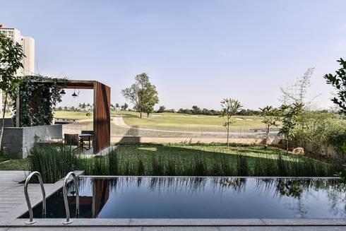 Premium Villa :  Infinity pool by Racheta Interiors Pvt Limited