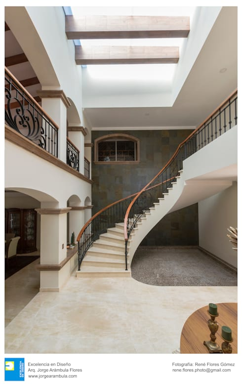 escalera: Escaleras de estilo  por Excelencia en Diseño