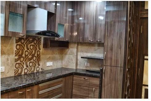 Modular kitchen:   by RID INTERIORS