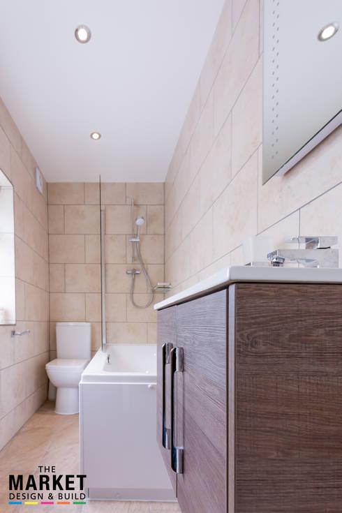THE AMERSHAM LOFT AND GARAGE CONVERSION: modern Bathroom by The Market Design & Build