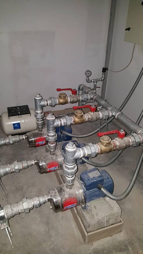 Instalación de Bombas de Agua Potable:  de estilo  por SCONCRETO S.A.C.