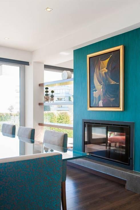 Zona de refeições : Sala de jantar  por Traço Magenta - Design de Interiores