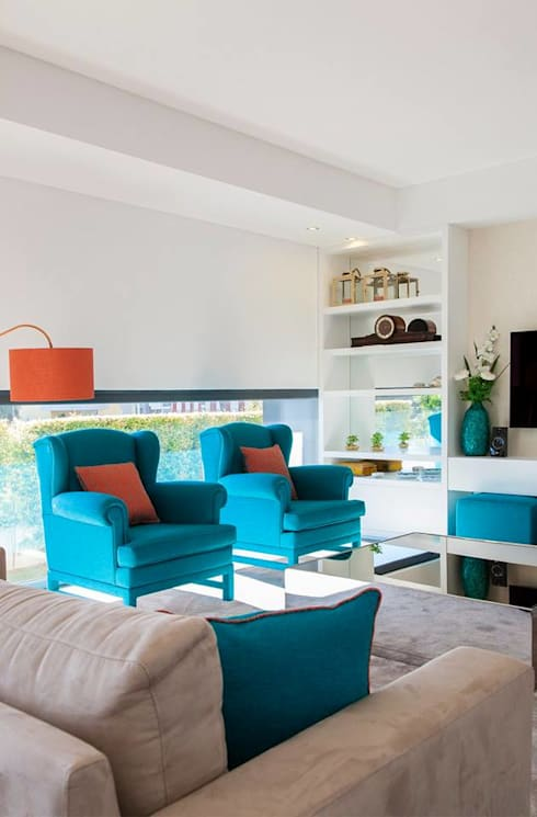 Zona de estar: Sala de estar  por Traço Magenta - Design de Interiores
