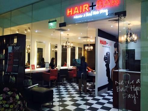 Hair + Bar salon:   by GK + BAM Architects