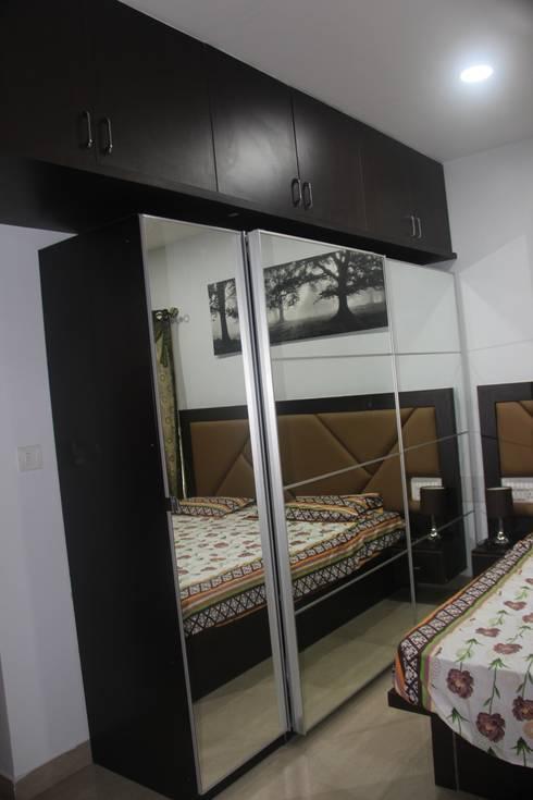 Salarpuria Gold Summit: modern Bedroom by Pebblewood.in