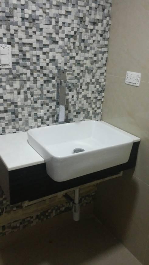 Baño visita - acabados: Baños de estilo minimalista por Arquigrafic, c.a.