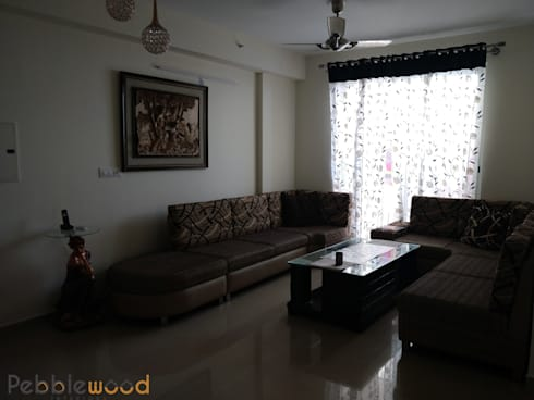 B6111—DLF Westend Heights: modern Living room by Pebblewood.in