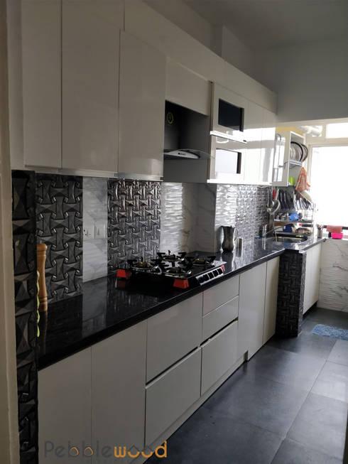 B6111 - DLF Westend Heights: modern Kitchen by Pebblewood.in