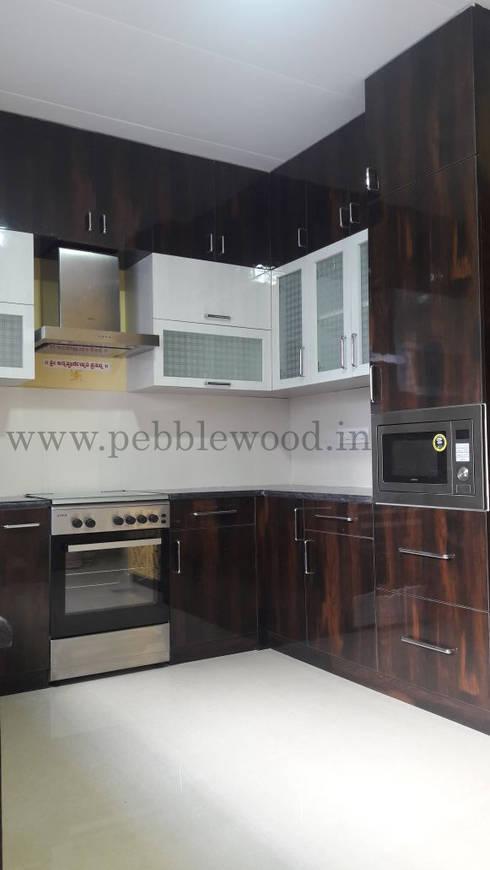 Nandi Citadel—E303: modern Kitchen by Pebblewood.in
