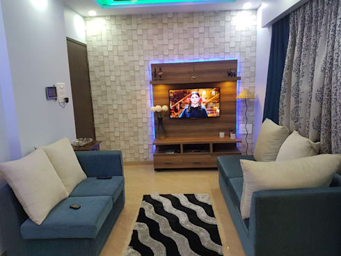 t.v unit and wall paper: modern Living room by Creative Focus