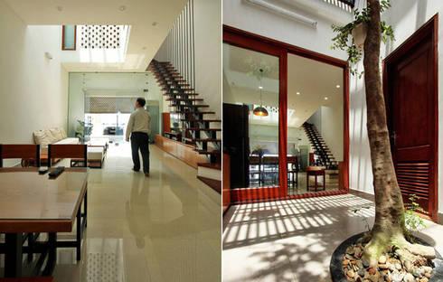 Không gian mở – xu hướng trong thiết kế nhà đẹp hiện đại:  Phòng khách by Công ty TNHH Xây Dựng TM – DV Song Phát