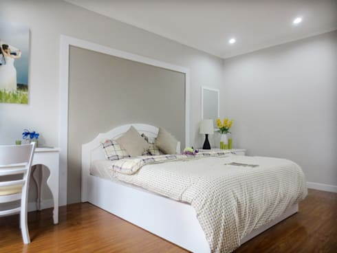 Phòng ngủ của hai vợ chồng vẫn sử dụng tông màu trắng chủ đạo.:  Phòng ngủ by Công ty TNHH Thiết Kế Xây Dựng Song Phát