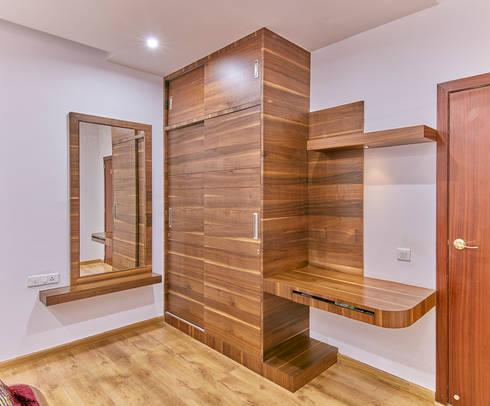 Full wood wardrobe in bedroom 1: modern Bedroom by NVT Quality Build solution