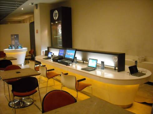 PROYECTOS CORIAN : Oficinas y tiendas de estilo  por MYGRA SUPERFICIES