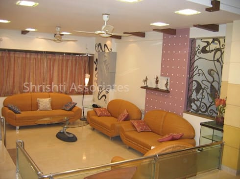 Living Room: modern Living room by Shrishti Associates