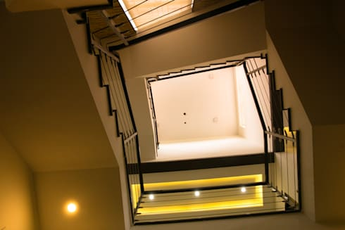 Double Height Space:  Floors by M/s Studio7 Architects