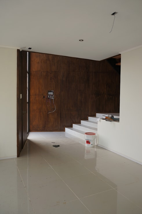 Hall acceso: Pasillos y hall de entrada de estilo  por Uno Arquitectura