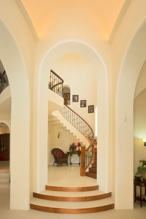 The House of Arches:  Stairs by S Squared Architects Pvt Ltd.