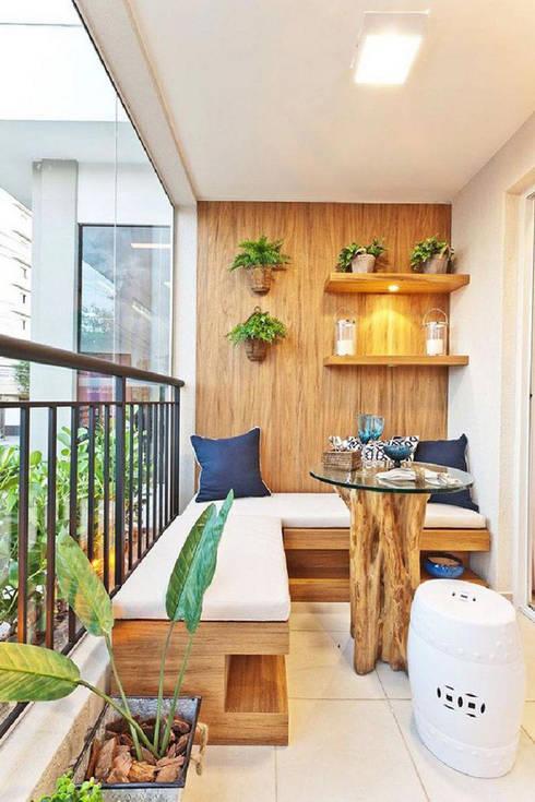 Một bộ bàn ghế nhỏ sẽ biến khoảng ban công nhỏ thành không gian thoải mái.:  Hiên, sân thượng by Công ty TNHH Thiết Kế Xây Dựng Song Phát