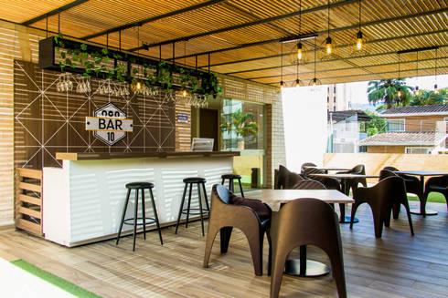 Hotel Lomas 10: Oficinas y tiendas de estilo  por zyxcolectivoarquitectonico