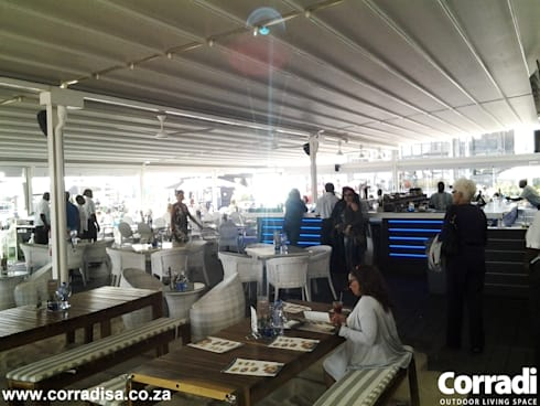 Corradi retractable roofs at Cape Town Fishmarket - V & A Waterfront Cape Town:  Bars & clubs by Corradi Outdoor Living Space