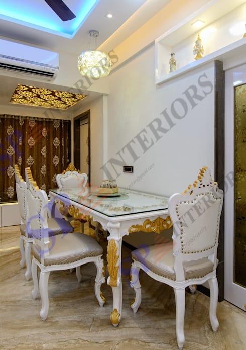 Mr. Gandhi:  Dining room by SP INTERIORS
