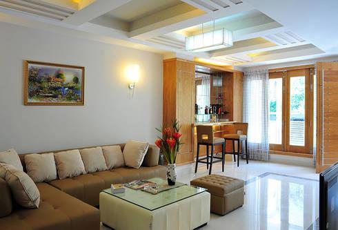 Không gian phòng khách, bếp ăn thông thoáng:  Phòng khách by Công ty TNHH Xây Dựng TM – DV Song Phát