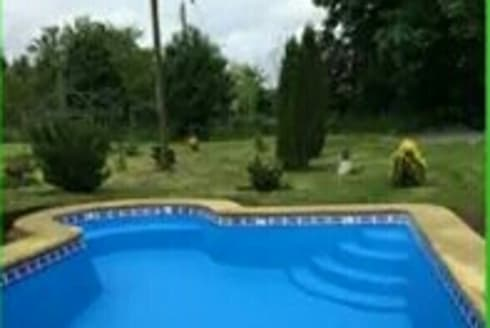 Piscina Bahia 8x4:  de estilo  por Construccion piscinas Reyal osorno