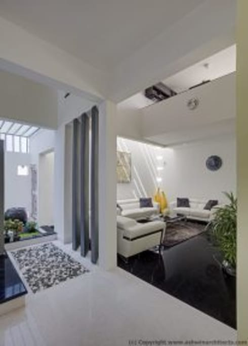 Striking House Interior Designs: 40×60, 4BHK: asian Living room by aaaa